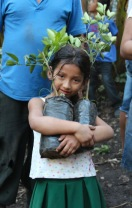Young girl learning about coffee through La FEM programming. Photo credit Chelsea Bay Dennis, Stone Hut Studios